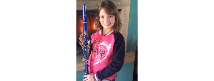 Aimée with her clarinet at her home