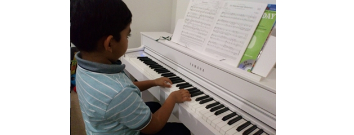 Haseeb playing the piano