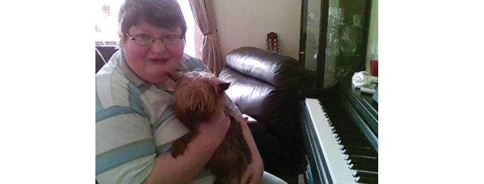 Online piano student Rebecca with her dog Toby