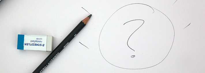 pencil, rubber and a sketched question mark on paper
