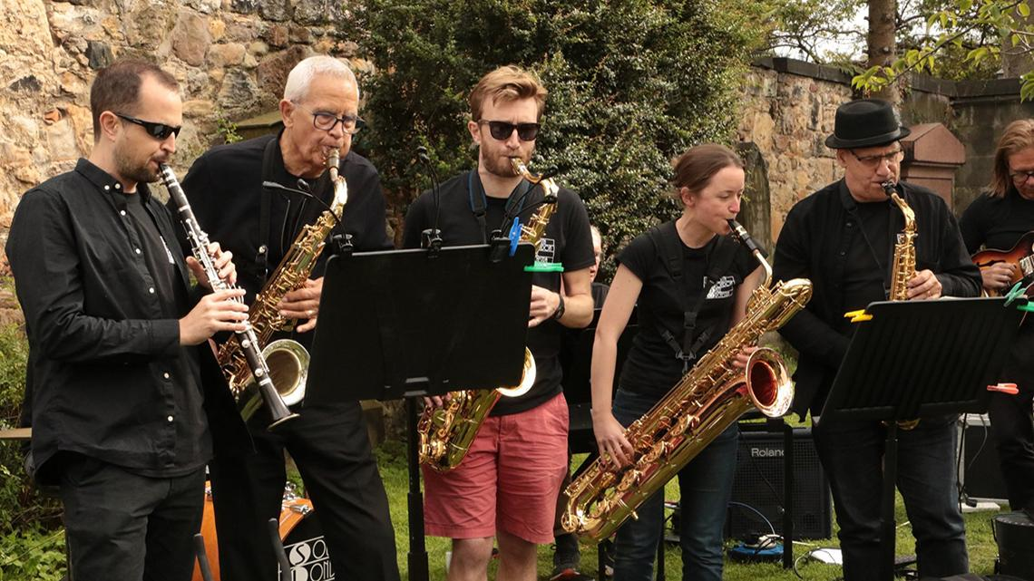 members of South London Jazz Orchestra busking