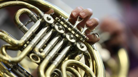 close up of a french horn being played