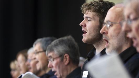 Men singing together in a concert