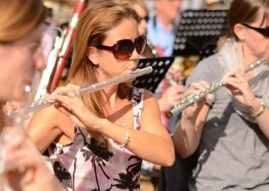 2015: Female flautists perform outdoors during summer Proms in the Park
