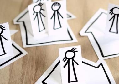 cutout paper figures and households assembled with social distance measures