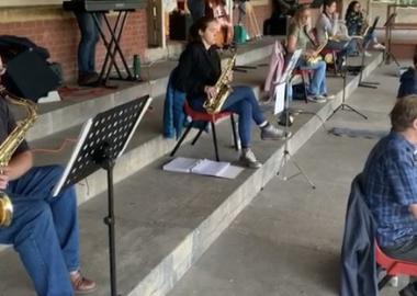 swing band rehearse with social distancing outdoors