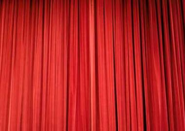 a closed pair of stage curtains