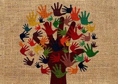 a tree with multi-coloured hands forming the leaves