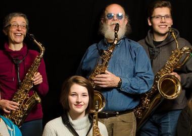 Aberdeenshire Saxophone Orchestra members pose with different types of saxophone
