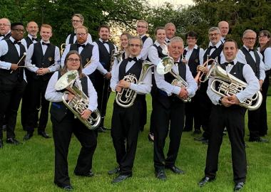 City of Bristol Brass Band pose in tuxes with their instruments