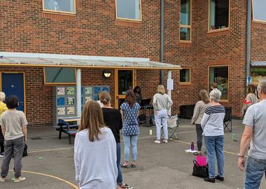 North Kingston Choir rehearse, socially distanced, in a school playground