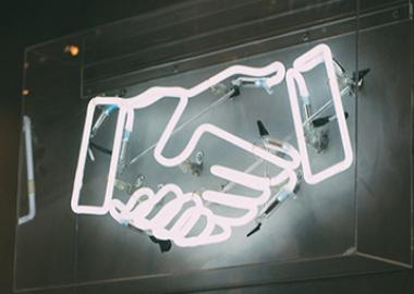 shaking hands lit up