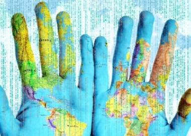 A pair of hands with a map of the world superimposed