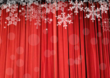 closed red stage curtains overlaid with snowflakes