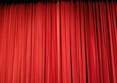 a closed red theatre curtain