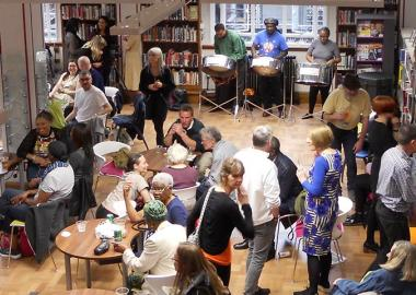 Library users socialise with a musical backdrop