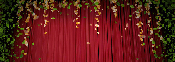 Red curtains framed by yellow and green leaves